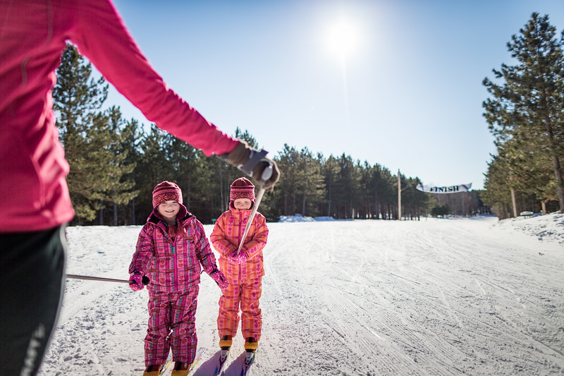 Two little girls skiing.