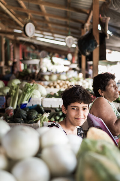 A young girl at the food market.