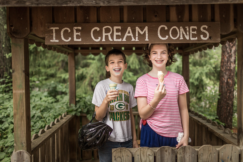A young boy and girl eating ice cream.