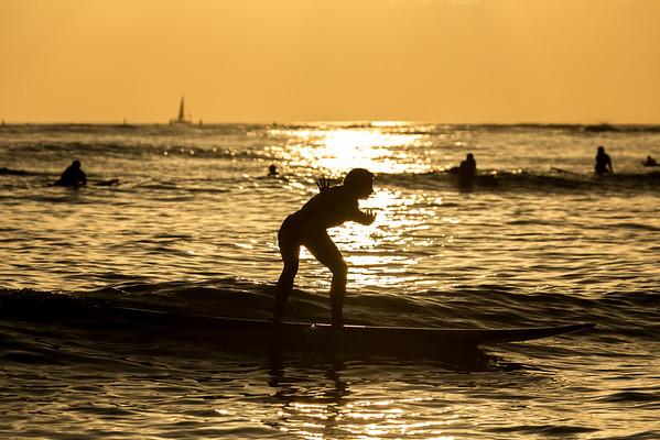 Surfing off Honolulu, Hawaii