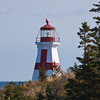 "East Quoddy Head Lighthouse, at the northernmost tip of Campobello Island, New Brunswick, Canada, was built in 1829 to assist in navigation for the treacherous Bay of Fundy. It is located on a small ""quasi-island"" (off the tip of Campobello) that is only accessible at low tide."
