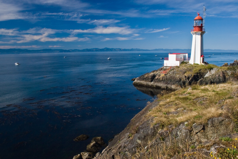 Sheringham Point Lighthouse on the west coast of Vancouver Island, near the town of Shirley. Built in 1912, it is an active lighthouse maintained by the Canadian Coast Guard.