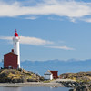 Fisgard Lighthouse off the coast of Victoria, British Columbia. Active Canadian Lighthouse dating from 1860. Open to the public. Located at the Fort Rodd Hill national historic site. Typical Canadian lighthouse - white with lantern painted red.