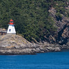 Portlock Point Lighthouse on Prevost Island in the Gulf Islands off the coast of Vancouver, British Columbia, in Canada. Active lighthouse with typical Canadian colors and structure. About 5 miles south of Active Pass Lighthouse. Canadian Coast Guard.