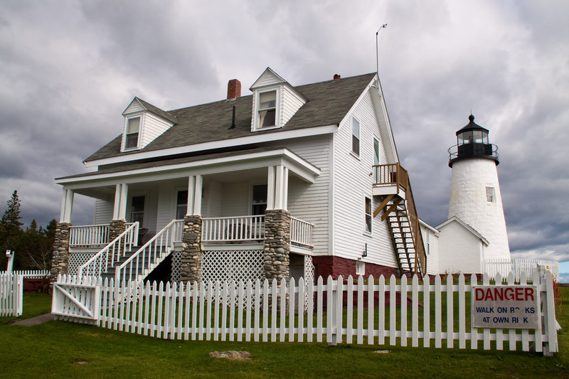 Pemaquid Point Lighthouse at Pemaquid point near New Harbor, Maine, was built in 1827, and the tower was rebuilt in 1835 and again in 1857. The keeper's stone dwelling was also replaced in 1857 by the wood-frame cape which still stands and houses the Fisherman's Museum. The original fourth-order Fresnel lens is still in operation. Pemaquid Point Lighthouse is famous for the striated rock formations on the cliffs below the lighthouse, which resemble ocean waves turned to stone.