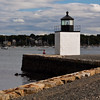 Derby Wharf Light in Salem, MA, built in 1870. The lighthouse is owned by the National Park Service and is pat of the Salem Maritime National Historic Site. The lighthouse is a breakwater type lighthouse for inner harbor protection. The grounds are open, but the tower is closed.