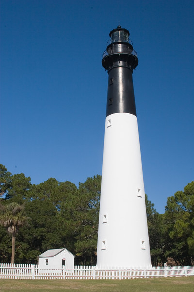 The Hunting Island Lighthouse is the only historic lighthouse in South Carolina that is officially opened for climbing. The original structure was built in 1859 and rebuilt in 1875 after it was destroyed during the Civil War. A unique feature of the lighthouse is that it was constructed of interchangeable cast-iron sections so it could be dismantled should it ever need to be moved.  Severe beach erosion made it necessary to relocate the lighthouse 1.3 miles inland in 1889. <br /> Hunting Island's lighthouse is the only historic lighthouse in South Carolina open to the public. It is also listed on the National register of Historic Places.