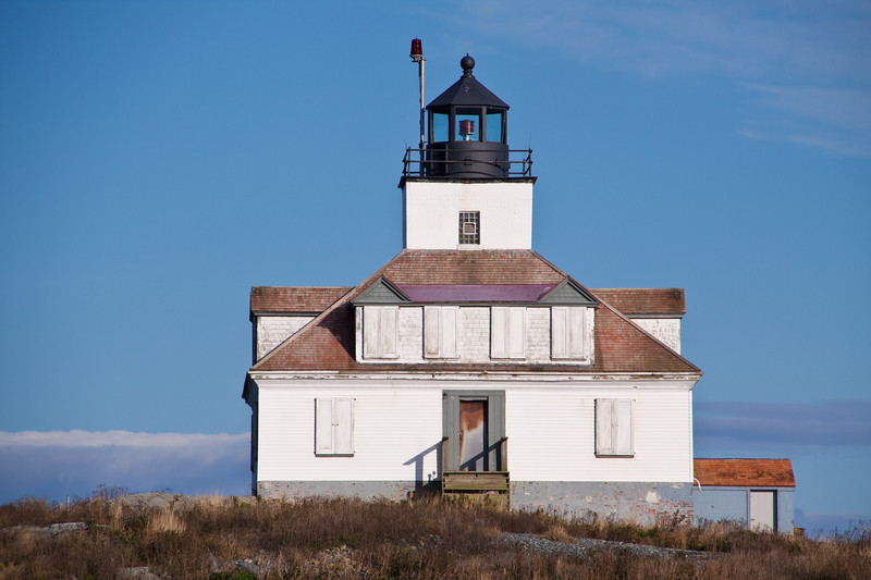 Egg Rock Lighthouse, on an island in Frenchman Bay, can be seen from various overlooks on Acadia National Park Loop Road on Mount Desert Island. It was built in 1875, on this barren rock island, and still flashes its beacon at five second intervals to mark seaward approaches to Bar Harbor. It was automated in 1976.