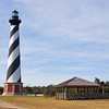 """The Cape Hatteras Lighthouse, known as """"America's Lighthouse,"""" is the tallest brick beacon in the U.S., standing 208-feet high. The substantial structure, built in 1870, is black and white spiral-striped and the international symbol of the North Carolina coast. The lighthouse, one of our most recognized and beloved landmarks, is open for climbing from mid-April through Columbus Day."""