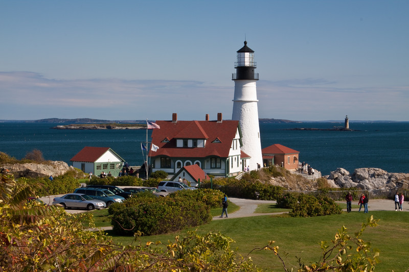 Portland Head Lighthouse, at Portland, Maine, was established in1791, is the oldest lighthouse in Maine. It was completed during George Washington's third year as president, and, remarkably, the original buildings still remain standing, though it has benefited from numerouse repairs and renovations. It is one of the most photogenic and most photographed lighthouses in the Eastern US. The Ram Island Ledge Light is also visible in the distance.