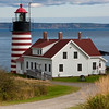 West Quoddy Head Lighthouse at Lubec, Maine, built in 1808 (and replaced in 1831 and again in 1858)  at the entrance to Passamaquoddy Bay, marks the easternmost  point in the contiguous continental USA. One of the most attractive of US lighthouses, it was automated in 1988 and is now owned by the Maine Bureau of Parks and is managed under the Maine Lights Program.