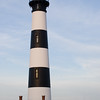 Tall and slim, with bold black alternating with stark white circular stripes the 156-foot Bodie Island Lighthouse sits not on an island at all; it is located on the soundside of Highway 12, between Nags Head and Oregon Inlet. It was completed in 1872, the third lighthouse built in this area. The first was destroyed by a storm and the second by war.