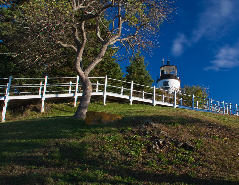 Owl's Head Lighthouse in Owl's Head State Park in Maine was built in 1825, and, with its powerful fog horn and its fourth-order Fresnel lens,  it still guides mariners safely into Rockland Harbor. Presently an active US Coast Guard facility, the keeper's quarters are off-limits, but the grounds are open to visitors.