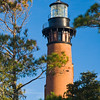 The Currituck Beach Lighthouse at Corolla is the only light in North Carolina that is still housed in its original structure. The tower is 163 feet tall. <br /> <br /> First put into service on December 1, 1875, it still serves as an aid to navigation. Each of the many lighthouses in the region received distinctive painted exteriors to aid identification --except the light at Corolla. It was distinguished by being left unpainted, allowing the visitors to view nearly one million bricks!<br /> <br /> The lighthouse is open to visitors from Easter to Thanksgiving.