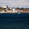 Portsmouth Harbor Lighthouse is located within Fort Constitution on the Piscataqua River in New Castle, New Hampshire, at the entrance to Portsmouth Harbor.The station was established in 1771 and was the 10th of 11 light stations established prior to the American Revolution. The tower was replaced in 1804 and fitted soon after with a fourth-order Fresnel lens. It was replaced again in 1878, this time by a new 48-foot cast-iron brick-lined tower. It was automated in 1960. The lighthouse remains an active aid to navigation and is part of the Fort Constitution Historic Site, adjacent to an active Coast Guard Station.