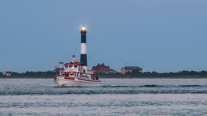 Fishing Boat and Lighthouse