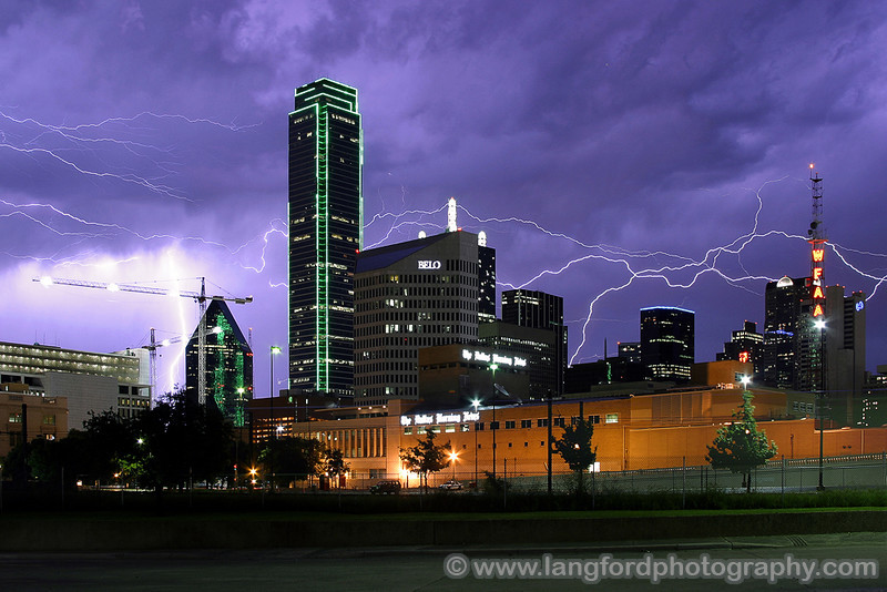 "Electrical Evening - Dallas, TX  Lightning arcs across the sky over downtown Dallas.  A series of strong summer storms had pounded the Dallas area 30 minutes before this shot was taken.  The storms had knocked out several of the green argon tubes in the building pictured here.  After the storms had passed, I was treated to several hours of very photogenic lightning.  This was captured with my Canon 10D and 20mm lens. <BR><BR>Many of these images can be purchased in my For Sale Area <a href=""http://www.langfordphotography.com/For-Sale/Lightning/290976_kshXXM"">Here</a>"