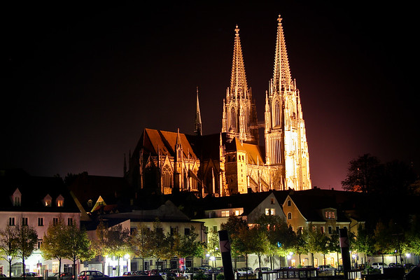 """One of my favorite shots,  this is also a handheld shot taken from a bridge (balanced again) in the """"valley"""" looking up at the catheral. Dom Saint Peter in Regensburg, Germany is quite impressive.  This photo was done at ISO 200 and 6 second shutter speed.  I had to do a little bit of post processing to clean up the sky,  and brighten up the trees and road in the foreground. Also some sharpening for the steeples.   Again, one of my favorites."""