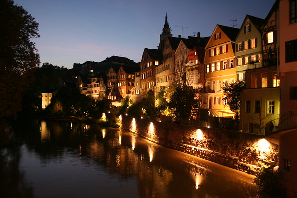"This photo was taken at dusk in the beautiful city of Tubingen, Germany on Neckar, outside of Stuttgart .    It was taken on a weekend trip where I went to the Cannstatter Volkfest,  which had been termed the ""real"" Oktoberfest (Munich will disagree).  Anyway, this ""handheld"" shot was taken by balancing my camera on the bridge, and shooting at ISO 800 and .6sec shutter speed.  I have done minimal post processing. This photo is currently ranked as a ""Top 500"" photo of all-time on Smugmug."