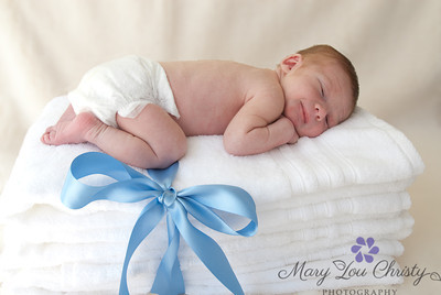 Newborn posed on soft new towels.