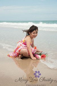 A dress and roses at the beach? Doesn't get much more fun than this!