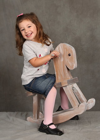 Girl on Rocking Horse - Visual Image Dayton