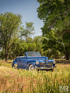 Automotive Photography of Blue Mercury Automobile