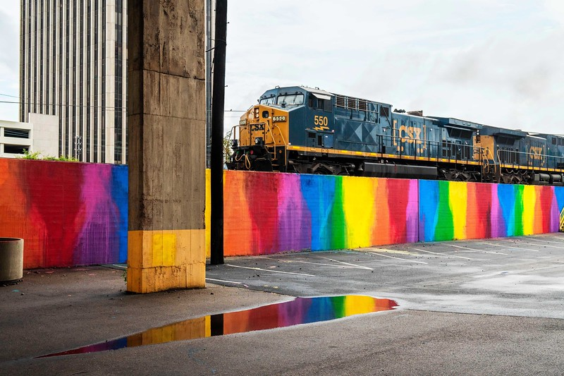 Train above rainbow wall