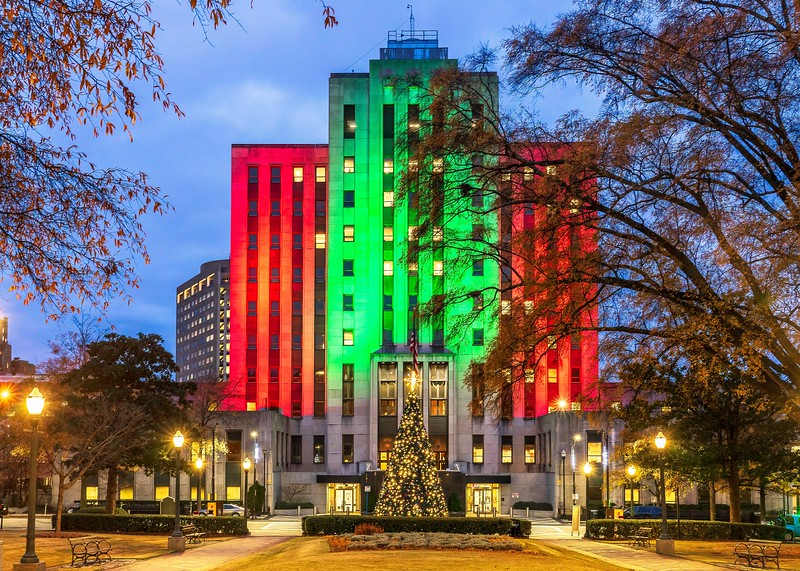 City hall with red and green at christmastime
