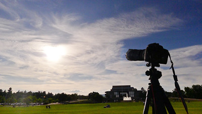 My camera and the sky, showing wispy clouds.