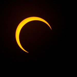 Cresent sun, partially eclipsed by the moon. Taken in Redding, California.