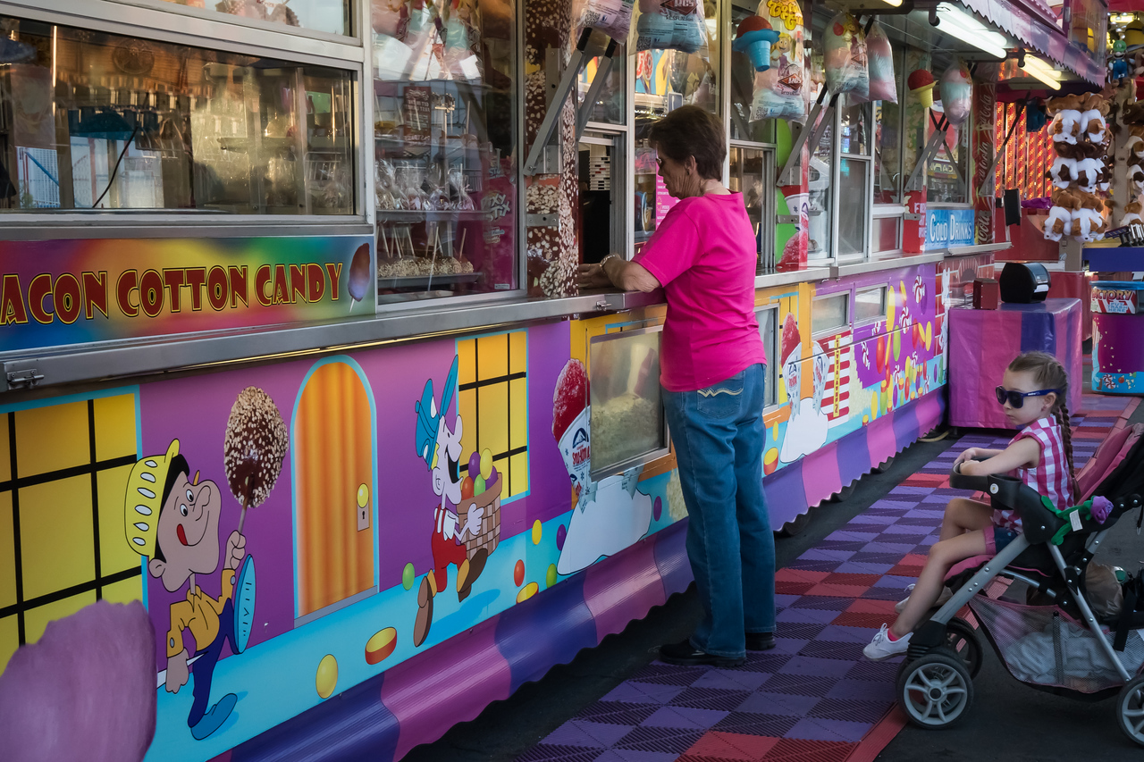 Woman making food purchase at Los Angeles County Fair