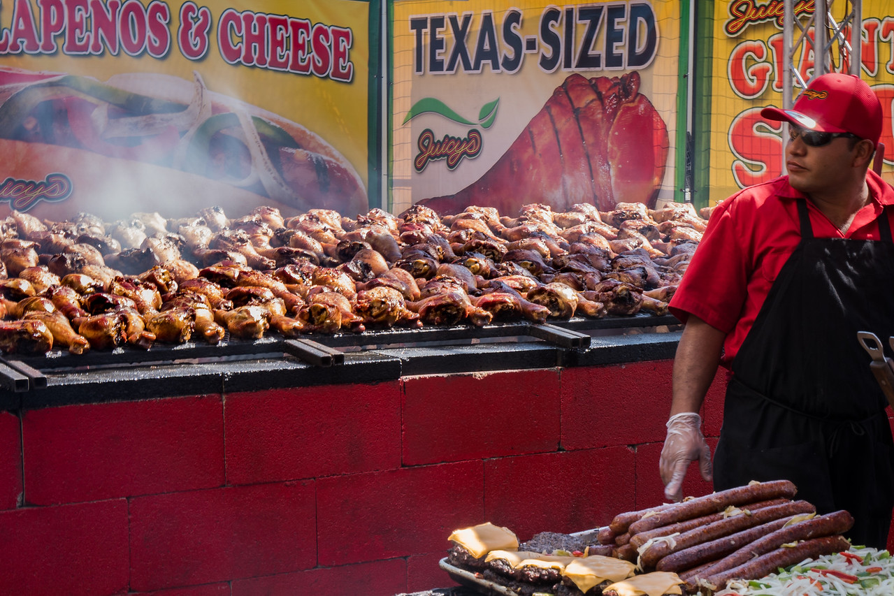 Dozens of roasted chickens awaiting customers at Los Angeles County Fair