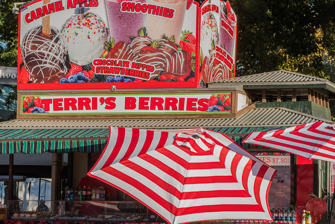 Red and white umbrelles at fruit stand at LA County Fair