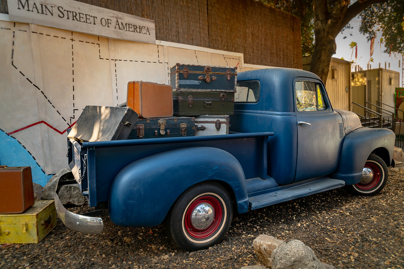 Old pickup truck loaded with suitcases, ready to set out on Route 66