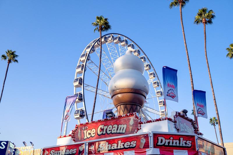 Fair food both and a ferris wheel