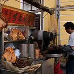 MACAU. ROASTING CHESTNUTS. OLD PORTUGESE QUARTER.