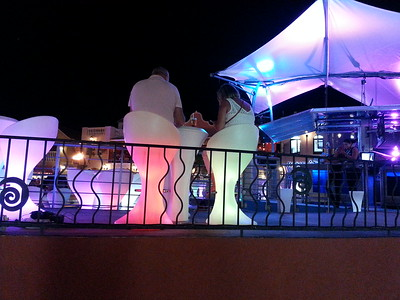 A couple enjoys the nightlife at the courtyard in uptown Aruba...May 2014.