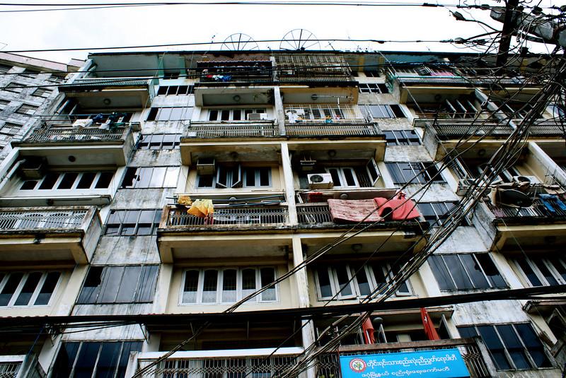 YANGON. RANGOON. OLD APARTMENTS. CITY CENTER. BURMA. MYANMAR.