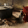 A MONK GETS HIS LUNCH. KITCHEN OF THE MONASTERY. AMAPURA. MANDALAY DIVISION.
