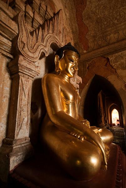 Buddha statue inside the Htilominlo Pahto, Bagan, Myanmar