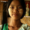 INWA. BURMESE GIRL WITH THANAKA (SUNSCREEN). MANDALAY DIVISION. MYANMAR | BURMA.
