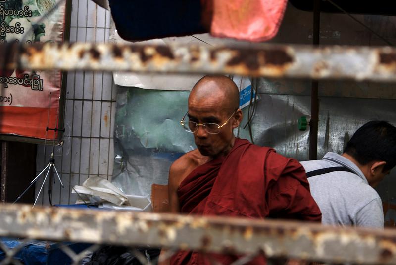 YANGON. RANGOON. MONK. CITY CENTER. BURMA. MYANMAR.
