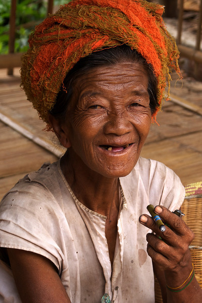 INLE LAKE. OLD WOMAN SMOKING HER CHERUT CIGARET. BURMA. MYANMAR.