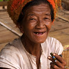 INLE LAKE. OLD WOMAN SMOKING HER CHERUT CIGARET. BURMA. MYANMAR.
