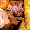 MEN APPLY GOLD LEAFS TO THE BUDDHA STATUE. MAHAMUNI PAYA (PAGODA). MANDALAY. MYANMAR. BURMA. MAHAMUNI BUDDHA.