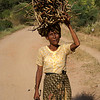 Archeological site of Bagan - Myanmar | Burma - lady carrying wood.