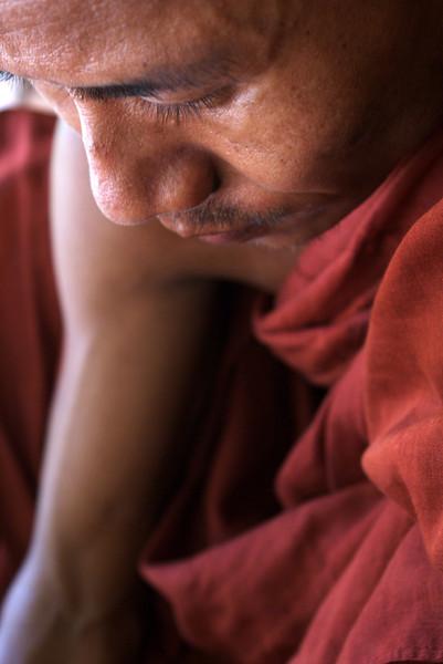 SAGAING. SAGAING HILL. A BHUDDIST MONK. MANDALAY DIVISION. MYANMAR. BURMA.