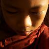 PORTRAIT OF A BIRMESE NOVICE. BAGAN. MYANMAR.