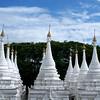 MANDALAY. SANDAMUNI PAYA. WHITE STUPAS AROUND THE MAIN PAYA. BURMA. MYANMAR.